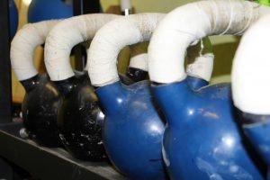 varying sizes of kettlebells